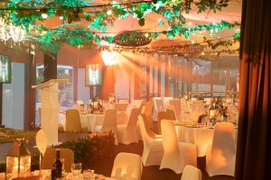 Brookwater Golf Course & Country Club's Full Venue Function Space with Lectern, Projector Screens and Stylised Decor