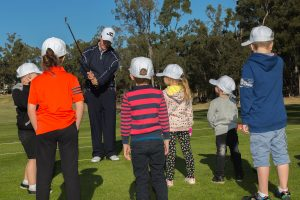 A group of children being taught golf at Brookwater